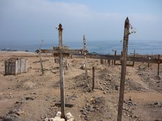 Inside the abandoned cemetery. At the left, It can be seen a child's grave.  This kind of cemeteries are common in this regions, because of the satellite cities that proliferated during the Chilean Nitrate Boom.
