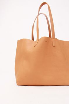 - natural leather tote bag