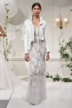 Bohemian and rock and roll brides will love this lace wedding dress from Monique Lhuillier - complete with white studded wedding leather jacket! (BridesMagazine.co.uk)