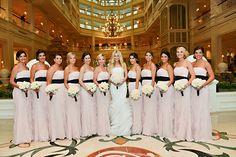 Romantic light pink bridesmaids dresses with black sashes at Disney's Grand Floridian Resort