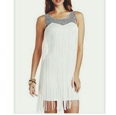 Short white and gold fringe dress Super sexy white dress with fringe. Gold zipper in the back. Size small, nwt, true to size. Make me an offer! :) Charlotte Russe Dresses Mini