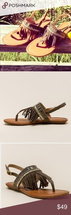 Fringe T-Strap Sandal Show off your modern festival style in the Report thong sandal. Tan  Textile upper with beaded detailing. Ankle strap with buckle closure. Open toe. Thong-style silhouette. Fringe detailing at vamp. Man-made lining and insole. Mini stacked wedge. Textile and synthetic sole. Heel Height: 1⁄2 in Report Shoes Sandals
