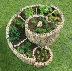 Make a herb spiral using chicken wire and filled in with stones