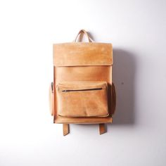 Handmade Orange leather backpack made from cowhide leather of vintage style  - One roomy compartment ( fits Laptop 15) - one slip pocket inside (18cm * 15cm) - strap width 2,7 cm - main compartment closes on snap buttons - one front zipper pocket 25 * 17 * 3cm (9,8 * 6,7 * 1,2 in) - two zipper pockets on sides 8 * 17 * 3 cm ( 3,15* 6,7 * 1,2 in) Available to order in black, gray, red, brown, dark blue, orange and green colors.  DIMENSIONS:  Height: 40 cm / 15,7 in Width: 30 cm / 11...