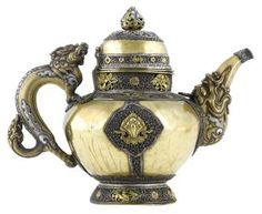Teapot of gilt metal, with globular body with applied silver bands and gilt mythical animals, and a spout and handle in the form of monstrous animals, everyday use: Tibet, Lhasa, late 19th century