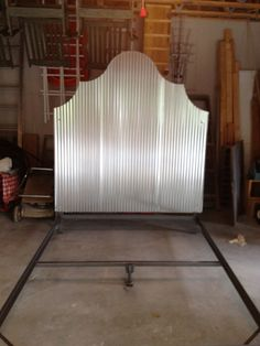 Corrugated tin headboard.  Next the footboard.