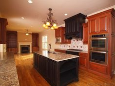 Kitchen Cabinets Cherry Wood kitchen idea of the day: two-tone kitchens in traditional homes