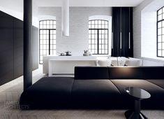 salle de séjour ouverte sur la cuisine blanche, aménagée avec un canapé noir, table basse noire et suspensions design