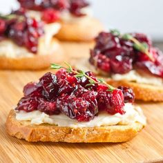 Balsamic Roasted Cranberries make a tangy sweet topping for Brie Crostini. Stunning, easy to make, and SO good!