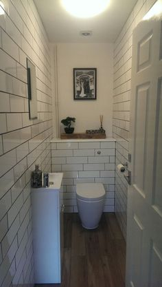 Downstairs cloakroom featuring subway tiles with concealed cistern and oak shelf Small Downstairs Toilet, Small Toilet Room, Downstairs Cloakroom, Wet Room Bathroom, Garage Bathroom, Small Bathroom, Bathroom Ideas, Cloakroom Ideas, Bathroom Inspo