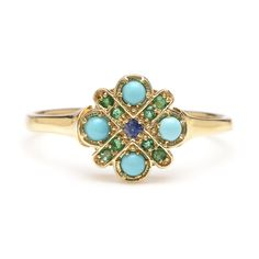 Turquoise Flower Ring | Turquoise cabochons are crossed with tiny emeralds and a single sapphire in this pretty vintage inspired ring. | Handmade in NYC