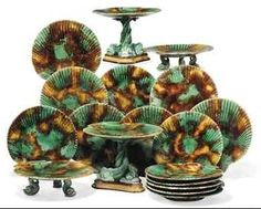 Wedgwood Majolica Dessert Service, with mottled, scallop-edged plates and compotes, with dolphin feet and pedestals.