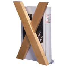 B could easily make something like this with our wood scraps.  SKRIBENT Book-end - IKEA
