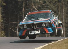 Iconic. Hans Joachim Stuck flying high in his BMW 3,5 CSL, at the Nurburgring, Flug Platz, 1974 - Love this photo!!!
