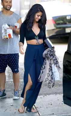 Selena Gomez shows off her toned tummy in this black and blue look.