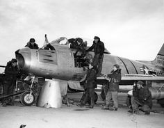 Servicing our best fighter plane, the F86 Sabre.