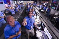 In a photo provided by NASA, the Mars Science Laboratory team in the MSL Mission Support Area reacts after learning the the Curiosity rover has landed safely on Mars and images start coming in at the Jet Propulsion Laboratory on Mars, Sunday, Aug. 5, 2012 in Pasadena, Calif.