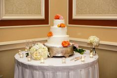For a simple, elegant pop of color, add a few fresh flowers to your wedding cake