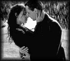 Kissing in the rain in black