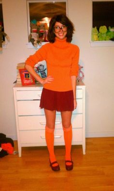 If you have orange this would be ideal. A Velma costume from Scooby Doo! A wig for the hair and some glasses, but it's do-able at home