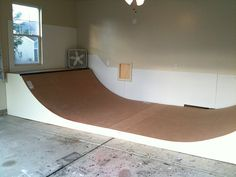 Finishing touches on the garage Mini Ramp Skateboard Storage, Skateboard Furniture, Skateboard Ramps, Skateboard Shop, Backyard Skatepark, Bmx Ramps, Boulder House, Mini Ramp, Skate Ramp