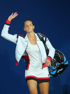 Karolina Pliskova Photos Photos - Karolina Pliskova of the Czech Republic walks onto the court before playing against Serena Williams of the United States during her Women's Singles Semifinal Match on Day Eleven of the 2016 US Open at the USTA Billie Jean King National Tennis Center on September 8, 2016 in the Queens borough of New York City. - 2016 U.S. Open - Day 11