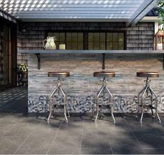 Spruce up your outdoor bar with gray and stone tiles #outdoorbar #outdooroasis #backyardgoals #tiles #tiledesigns