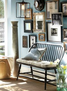 Painted black bench with gorgeous gallery wall above it