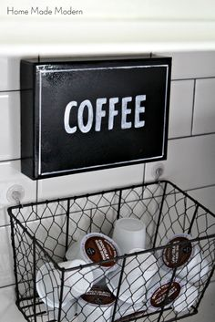 make a sign from a shoebox lid and a k-cup holder from a basket then hang it all on the tile with suction cups.