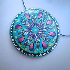 This is a Native American inspired feather medallion pendant.  The feathers, border, and other elements are from custom polymer clay millefiori canes.  They sit in a faux turquoise background.  I'll be teaching this technique along with my complex feather canes in new workshops for 2017.  You can find this one in my ETSY shop. https://www.etsy.com/listing/387359032 #debhart #rengalsa #polymer #etsy #polymerclaycanes #craftartedu #class #tutorial #workshop #handmadejewelry #handmade…