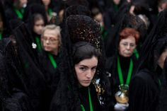 A penitent stood outside during a Holy Week procession in Zamora, Spain, Thursday. Holy Week, Photojournalism, Street Photography, Veil, The Outsiders, Spain, Boho, Thursday, Gypsy