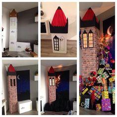 Sinterklaas toren decor 2013. De zwarte pieten beklimmen de sinterklaas toren in de woonkamer met allemaal pakjes. Toren is zelf gemaakt van kartonnen dozen en decoratie
