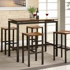 Furnish your dining area with the beautiful Brayden Studio® 5 Piece Counter Height Pub Set. It is made out of manufactured wood and metal, ensuring functionality and durability for years to come. The Pub set includes a table and four barstools.  The 5 Piece Counter Height Pub Set by Brayden Studio® is glazed with a fabulous finish, elevating your living space. The Pub Set has simple and clean lines, which merge perfectly with most home decors. You can use this pub set in a dining area or…
