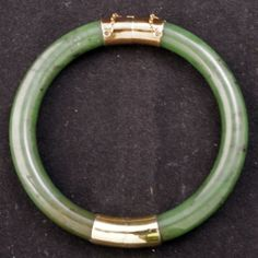 Segmented spinach green jade bangle bracelet with gold washed silver fittings $300