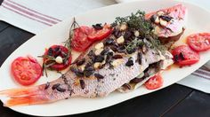 Emeril's Whole Roasted Red Snapper with Tomatoes, Lemons, Thyme and Parsley is the perfect weeknight spring dinner.