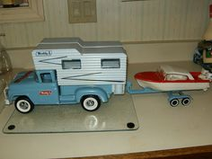 1961 Buddy L truck,camper,trailer,boat,and 2 outboard motors.......this would have been my favorite toy ever growing up....maybe still would be