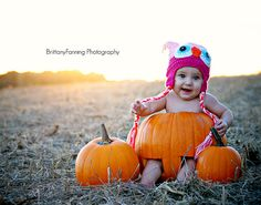 Baby girl in pumpkin. Fall photo. [ BrittanyFanning Photography ]