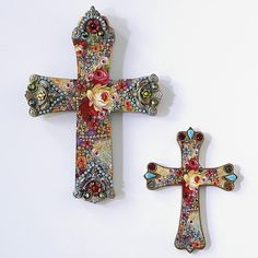 decoupaged crosses and heavily embellished....what neat gifts these would make.