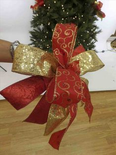 New Post christmas tree decorations with gold ribbons
