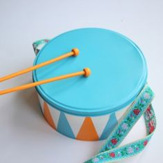 How to make a DIY toy marching drum using an old cake tin. Drums For Kids, Drum Lessons For Kids, Toy Cars For Kids, Winter Crafts For Toddlers, Toddler Crafts, Diy For Kids, Kid Crafts, Homemade Drum, Marching Drum