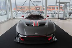Check out these amazing shots of the Aston Martin Vulcan finished in matte black and red stripes. Aston Martin Vulcan, Car Racer, Love Car, Car Wrap, Red Stripes, Matte Black, Luxury Cars, Ferrari, Vehicles