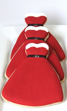 Mrs. Claus' Dress Decorated Cookies using a wedding gown cookie cutter, trimmed in black white and red