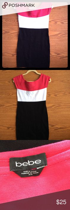 BEBE KNIT DRESS COLORBLOCK KNIT DRESS THAT HAS WHITE, BLACK, AND PINK COLORS. SHORT SLEEVED AND THE HAND TO THE KNIT IS EXQUISITE. RAYON AND VISCOSA. ALMOST NEW. BEBE Dresses