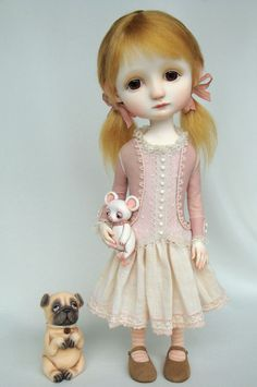 Eliza- original doll by Ana Salvador - looks like Ava when she's been crying!  Oh look!!! She even has a pug!