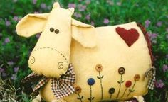 Cow pincushion | International Sewing Patterns. I would make it big. Use it for a toy or a pillow :) too cute.
