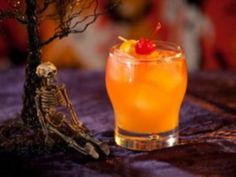 Zombie Cocktail Recipe - Like the walking dead, this cocktail packs a powerful punch thanks to apricot brandy and three types of rum: light, dark and high-proof Bacardi 151. Grenadine and orange juice give the drink its lovely pumpkin hue.