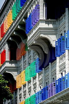 The amazing 1934 MICA Building on Hill Street has 911 windows with shutters all painted in vivid colours in the historic heart of Singapore - Lee Snider Photo Images.