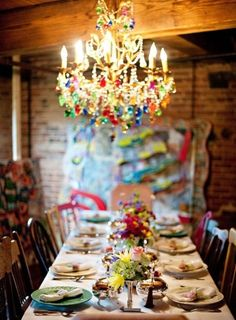 Boho Chich - ladies you're going to want a planner for this one! dining rooms, table settings, crystal chandeliers, colors, dinner parties, boho, bohemian style, rainbow, light