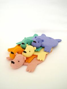 http://www.etsy.com/listing/95881897/rainbow-set-of-bear-rug-coaster-set-of