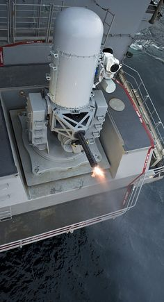A close-in weapons system fires during a pre-aim calibration aboard the aircraft carrier USS Harry S. Truman (CVN 75).